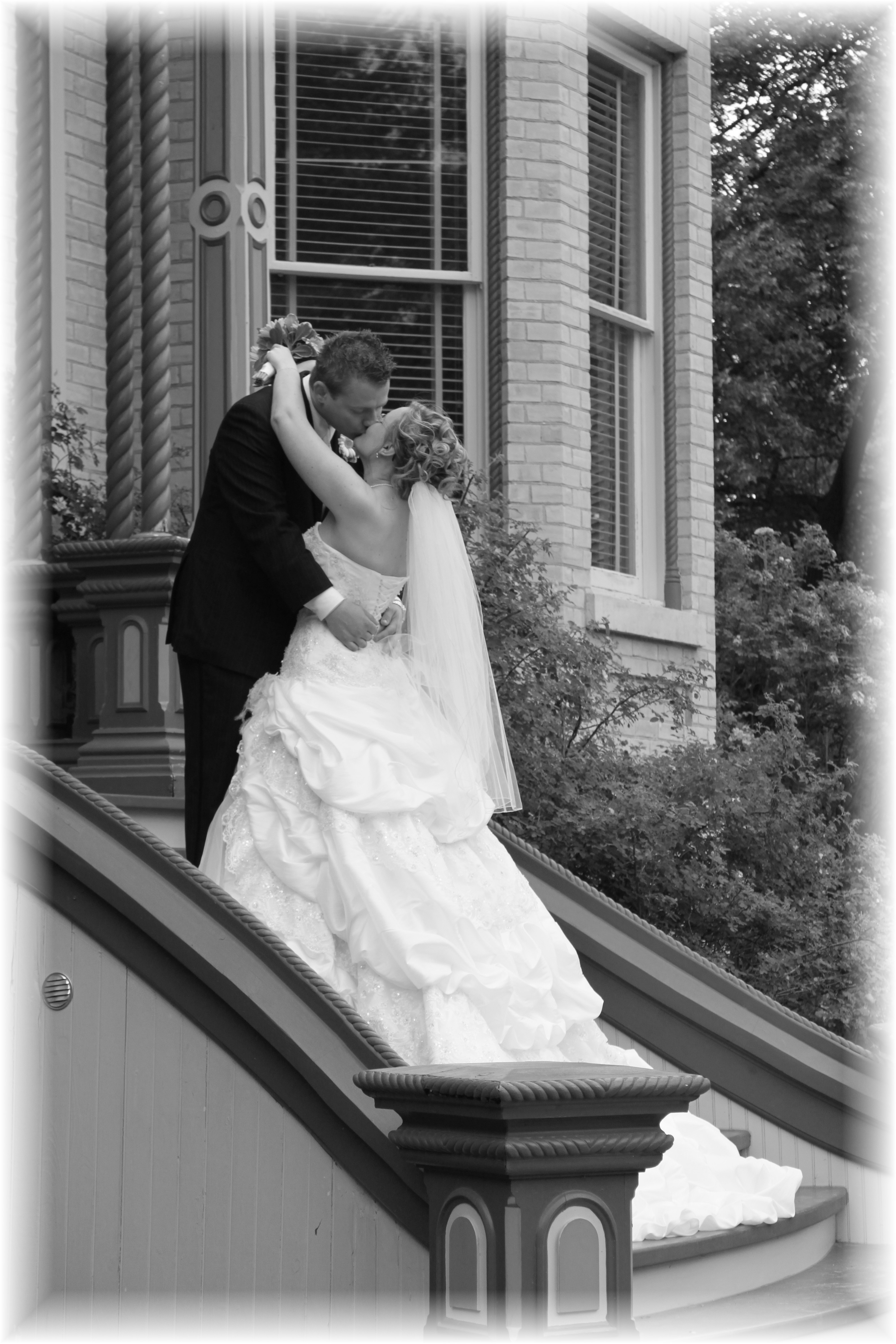 Couple kissing on front steps