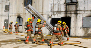 Firefighters lifting ladder